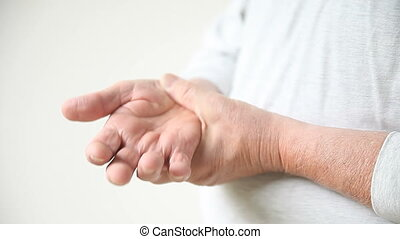man with thumb pain