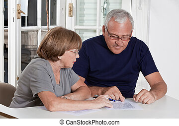 Mature Couple playing Scrabble Game - Portrait of mature...