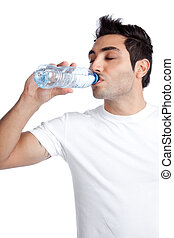 Man Drinking Water from Bottle - Portrait of young man...