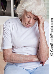 Senior Woman having Headache - Portrait of a senior woman...