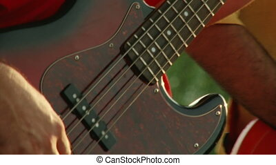 Bass guitar, red, closeup