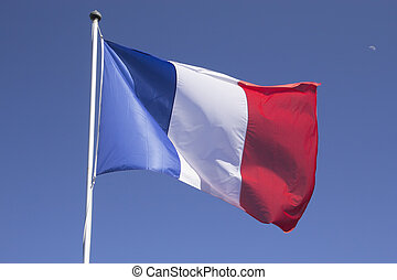 French flag on the mast Blue sky with the moon in the...