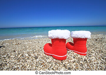Santa Claus boots on the beach