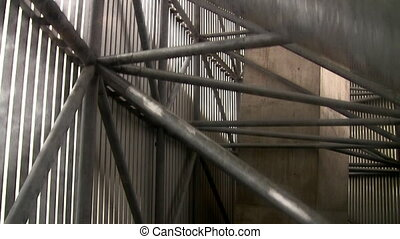 Lift moving upwards - View of metal and concrete...
