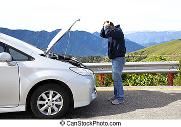 angry man with breakdown car on the country road
