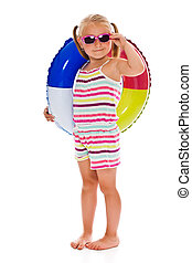 little girl with sunglasses and inflatable ring on white...