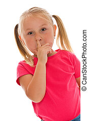 Little girl picking her nose studio shot