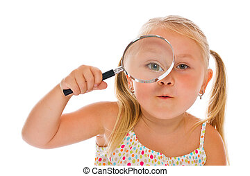 the little girl looking through a magnifying glass - the...