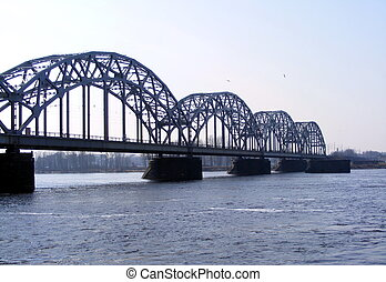 Railway bridge over the beautiful river Daugava in Riga,...