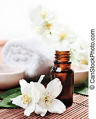 Essential Oil - Essential oil with jasmine flower on wooden...