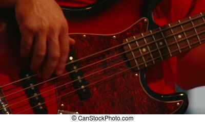 Bass guitar, closeup - Bass guitar, red, low light