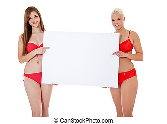 girls in bikini holding blank white - Two attractive girls...