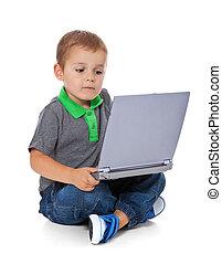 Boy using computer - Full length shot of a cute litte boy...