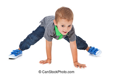 Cute boy doing sports - Full length shot of a cute litte boy...