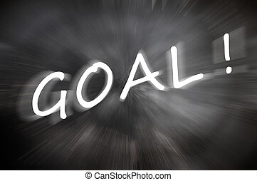"""Chalk drawing of """"Goal"""" word written on a blurred chalkboard with motion rays"""