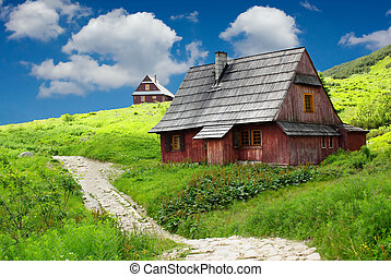 Mountain shelter house with beautifle blue sky with clouds