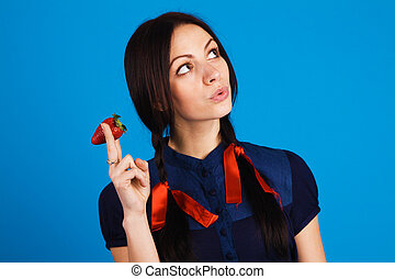 Young beautiful woman quot;smokingquot; a strawberry - Young...