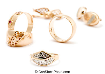 Rings and ear rings - object on white - Rings and ear rings