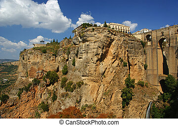 Ronda - Cityscape of Ronda resting on a mountain with Puente...