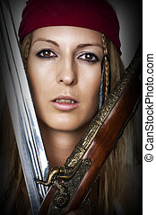 Close up portrait of female pirate with blade of sword and...