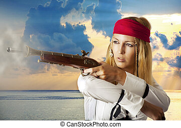 Young woman pirat shooting from her hand gun outdoor