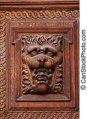 Woodcarvings. Detail of the gate on Old Town Hall in Prague.