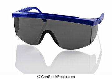 Plastic Safety Glasses - Plastic safety glasses on a...