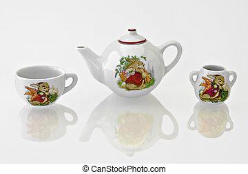 Rabbit Tea Set - Rabbit tea or coffee set on a reflective...