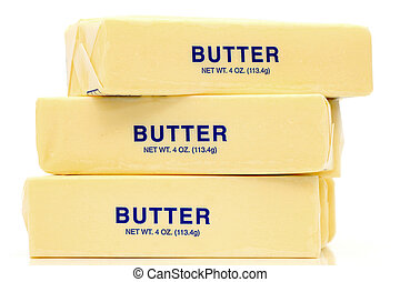 Butter Quarters - Traditional wrapped butter sticks on white...
