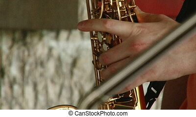Saxophone - Man play Saxophone, closeup