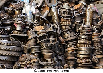 mechanic part - stack of rusted metallic car parts in garage