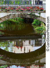 Old stone bridge on stream Leuk too Leukbach and geranium...