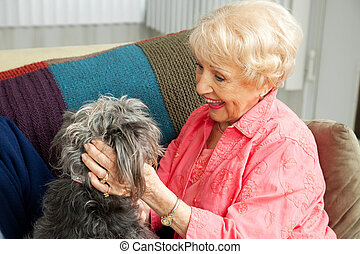 Senior Lady Loves Her Dog - Beautiful senior lady pats her...