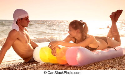 Couple On The Beach - Young couple enjoying summer vacation...
