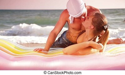 Loving Couple Kissing On The Beach - Young Loving Couple...
