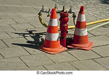 Street hydrant with traffic cones - A red street hydrant...