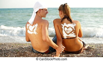Summer Beach Vacation - Young couple enjoying a beach...