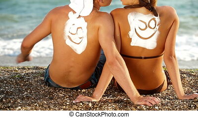 Young Couple Enjoying On The Beach - Happy young couple...