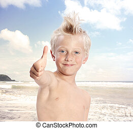 Blonde Boy Giving Thumbs Up at the Beach - Young Blonde Boy...