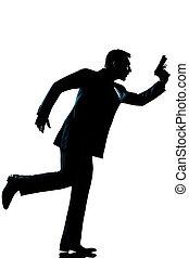 silhouette man full length running holding gun