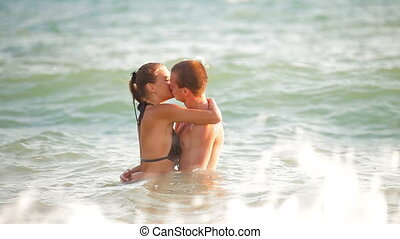 Loving Couple Kissing In The Sea