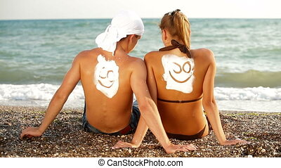 Happy Couple On The Beach - Happy young couple enjoying...