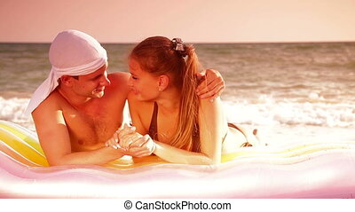 Young Couple On The Beach - Young couple enjoying summer...