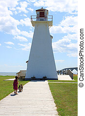 Little girl and lighthouse
