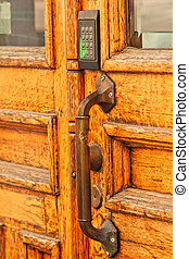 Old wooden door, with modern code opener