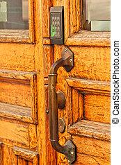 Old wooden door, with modern code opener