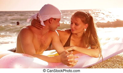 On the Beach - Young couple enjoying a beach vacation