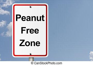Peanut Free Zone - An American road sign with sky background...