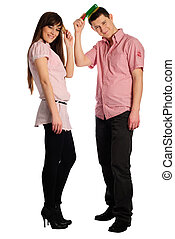 Couple comb oneself - Couple dressed in pink clothes comb...