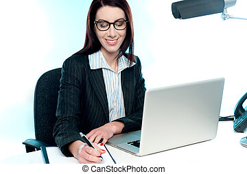 Businesswoman writing an important document - Smiling...
